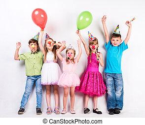 cute children celebrating birthday