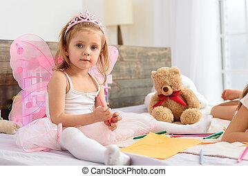 Cute children having fun in bedroom