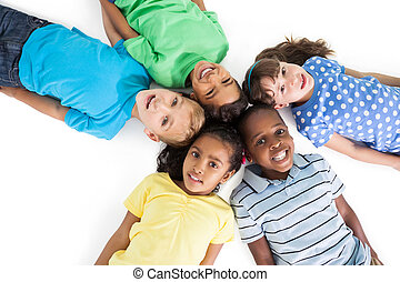 Cute children lying in a circle on white background