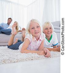 Cute children lying on the carpet s