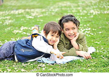 Cute children on meadow