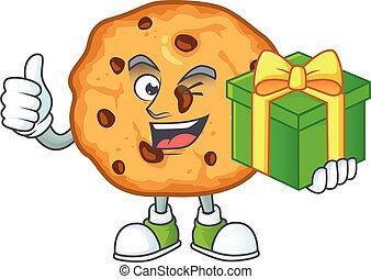 Cute chocolate chips cookies character holding a gift box