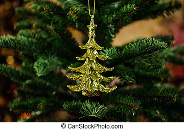 Cute Christmas tree decoration toy in the form of golden Christmas tree