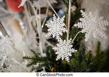 Cute Christmas tree decoration toys in the form of a white snowflakes