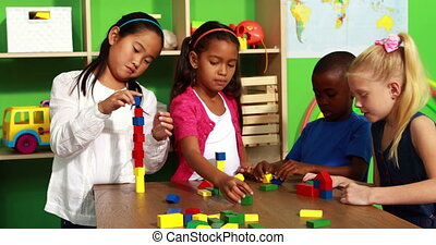 Cute classmates playing with blocks