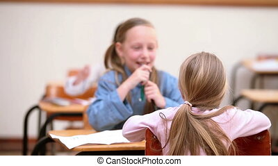 Cute classmates talking together