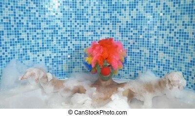Cute clown man in the bath with copious foam. humorous ...