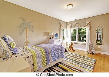 Cute colorful kids bedroom with single bed and white dresser.