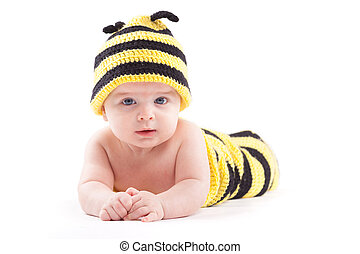 cute confused baby boy in bee costume