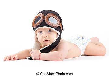 cute confused baby boy in diaper and pilot hat