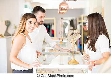 Cute couple buying some jewelry together
