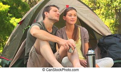 Cute couple drinking coffee outside