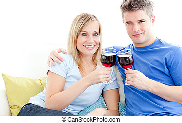 Cute couple drinking wine together