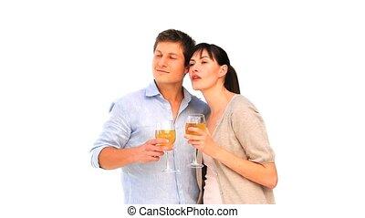 Cute couple enjoying a glass of wine