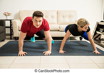 Cute couple exercising together at home