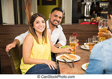 Cute couple hanging out with friends