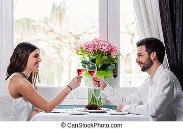 Cute couple having romantic dinner. - Close up portrait of...