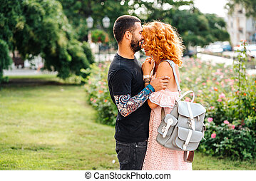 Cute couple in summer park