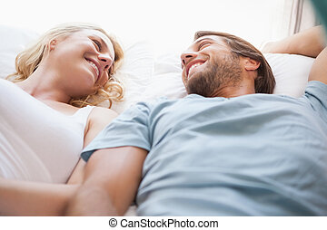 Cute couple lying on a bed