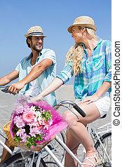 Cute couple on a bike ride