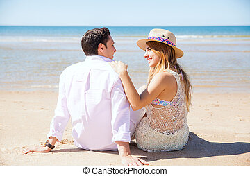 Cute couple on a date at the beach