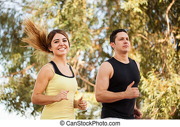 Cute couple running outdoors
