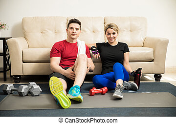 Cute couple taking a break from exercising