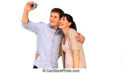 Cute couple taking a picture of themself