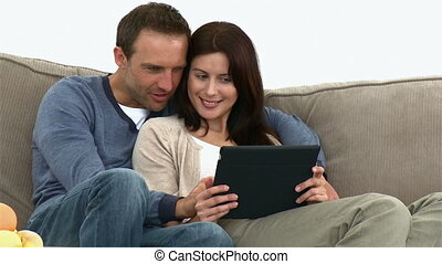 Cute couple using a computer tablet