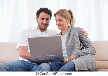 Cute couple using a notebook