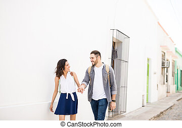 Cute couple walking and looking each other