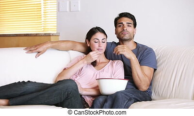 Cute couple watching the television