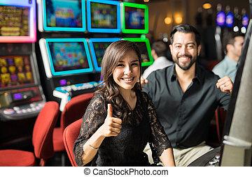 Cute couple winning in a casino