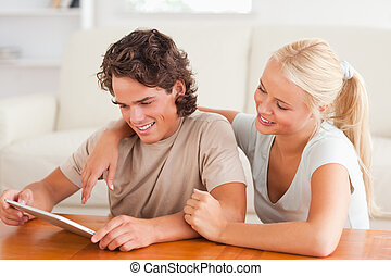 Cute couple with a tablet
