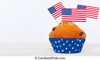 Cute cupcakes with american flag on white background