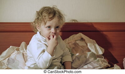 Cute curly boy watching TV