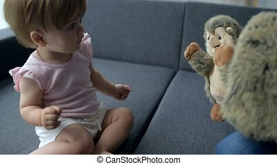 Cute daughter crying after looking at her toys