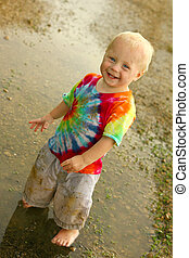 Cute Dirty Baby in Rain Puddle