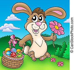 Cute Easter bunny on meadow