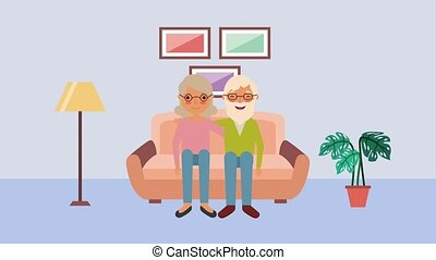 cute elderly couple sitting on sofa in living room
