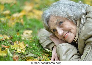 Cute elderly woman in the park