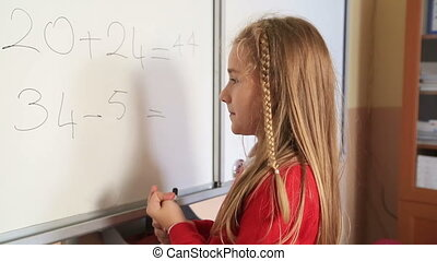 Cute elemantry girl - Little schoolgirl solving mathematic...