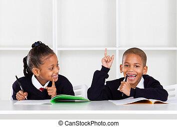 cute elementary school kids in classroom