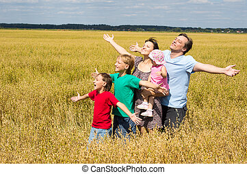 cute family at field