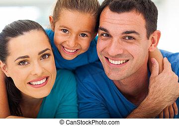 cute family face closeup - cute family of three face closeup...