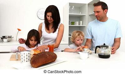 Cute family having breakfast