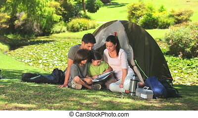 Cute family looking at a map