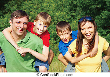 family of a four at nature - cute family of a four at nature