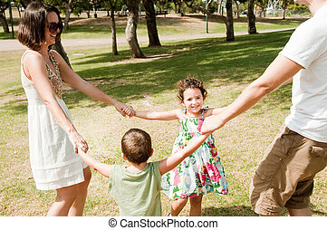 cute family playing in the park