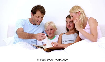 Cute family reading together